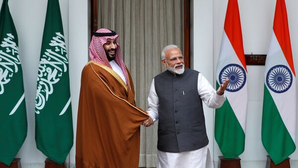 Saudi Arabia's Crown Prince Mohammed bin Salman shakes hands with India's Prime Minister Narendra Modi ahead of their meeting at Hyderabad House in New Delhi, India, February 20, 2019 - Sputnik International