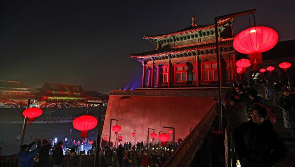 Visitors tour the Forbidden City decorated with red lanterns and illuminated with lights during the Lantern Festival in Beijing, Tuesday, Feb. 19, 2019. - Sputnik International