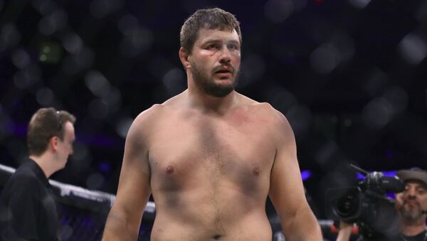 Matt Mitrione stands in the cage after a win against Fedor Emelianenko in a mixed martial arts bout at Bellator 180 on Saturday, June 24, 2017, in New York - Sputnik International
