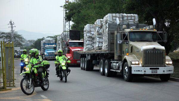 FILE PHOTO: Police escort trucks arriving at a warehouse, where international humanitarian aid for Venezuela will be stored according to authorities, near the Tienditas cross-border bridge between Colombia and Venezuela, in Cucuta, Colombia, Feb. 16, 2019. - Sputnik International