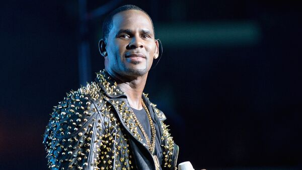 In this file photo taken on June 29, 2013, R. Kelly performs onstage during R. Kelly, New Edition and The Jacksons at the 2013 BET Experience at Staples Center in Los Angeles, California. R&B star R. Kelly has been charged with 10 counts of aggravated criminal sex abuse, at least some involving minors, a Cook County court official said Friday, February 22, 2019. - Sputnik International