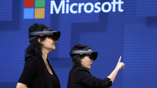 FILE- In this May 11, 2017, file photo, members of a design team at Cirque du Soleil demonstrate use of Microsoft's HoloLens device in helping to virtually design a set at the Microsoft Build 2017 developers conference in Seattle. Federal contract records show the U.S. Army has awarded Microsoft a $480 million contract to supply its HoloLens headsets to soldiers. The head-mounted displays use augmented reality, which means viewers can see virtual imagery superimposed over the real-world scenery in front of them. Microsoft says the technology will provide troops with better information to make decisions - Sputnik International