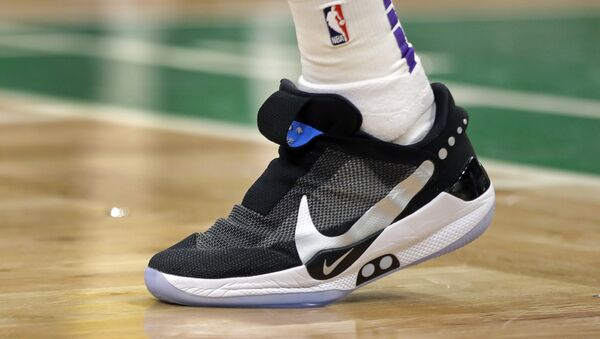 In this Feb. 7, 2019, photo, Los Angeles Lakers forward Kyle Kuzma walks on the court during an NBA basketball game against the Boston Celtics in Boston. He is wearing Nike's latest performance basketball shoes, which from concept to reality, took about three years to put together. Or 30 years, depending on how you count. The Nike Adapt BB _ a self-lacing smart shoe that can be controlled by a smartphone _ gets released to the public on Sunday, Feb. 17, 2019, a date that just happens to coincide with the NBA All-Star Game in Charlotte. It has a motor embedded within the shoe, and a hefty $350 price tag. - Sputnik International
