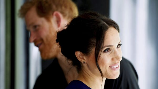Britain's Prince Harry and Meghan, Duchess of Sussex smile during their visit to the National Kiwi Hatchery at Rainbow Springs in Rotorua, New Zealand, Wednesday, Oct. 31, 2018 - Sputnik International