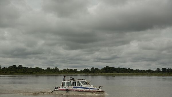 In this Aug. 8, 2018 photo, an ambulance boat crosses the Brahmaputra river in Majuli, in the northeastern Indian state of Assam - Sputnik International