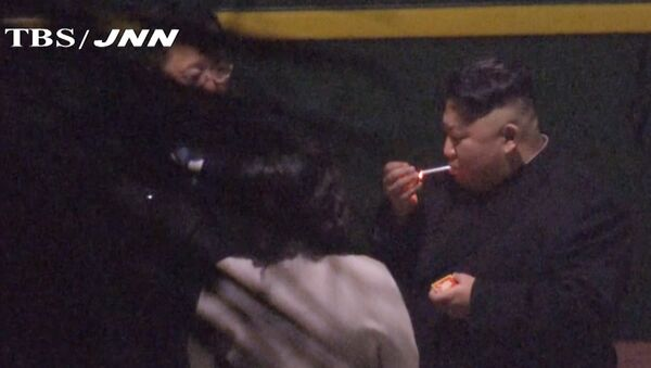 In this image made from Japan's TBS TV video on early Tuesday, Feb. 26, 2019, North Korean leader Kim Jong Un, a habitual smoker, takes a pre-dawn smoke break at the train station in Nanning, China, hours before his arrival in Vietnam for his high-stakes summit with President Donald Trump over resolving the international standoff over the North's nuclear weapons and missiles - Sputnik International