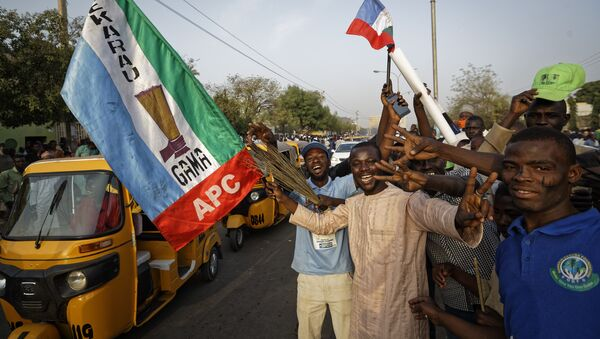 Supporters of President Buhari's ruling APC party celebrate results from the Nigerian elections on 25 February 2019 - Sputnik International