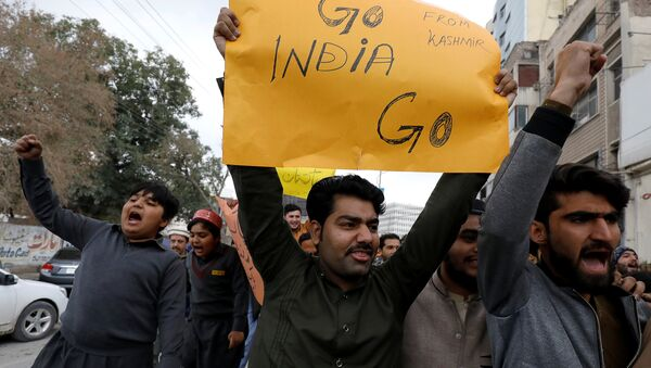 People carry a sign as they chant slogans against what they call airspace violation by the Indian military aircrafts, in a protest in Peshawar, Pakistan February 26, 2019 - Sputnik International