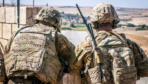 Two U.S. Soldiers keep an eye on the demarcation line during a security patrol outside Manbij, Syria, June 26, 2018 - Sputnik International