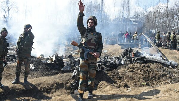Indian soldiers gesture near the remains of an Indian Air Force aircraft after it crashed in Budgam district, some 30 kms from Srinagar on February 27, 2019 - Sputnik International