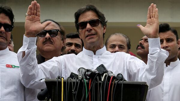 Cricket star-turned-politician Imran Khan, chairman of Pakistan Tehreek-e-Insaf (PTI), speaks after voting in the general election in Islamabad, July 25, 2018 - Sputnik International