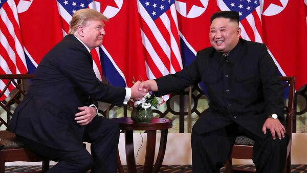 U.S. President Donald Trump and North Korean leader Kim Jong Un shake hands before their one-on-one chat during the second U.S.-North Korea summit at the Metropole Hotel in Hanoi, Vietnam February 27, 2019 - Sputnik International