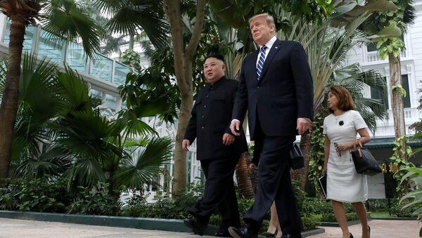 North Korea's leader Kim Jong Un and U.S. President Donald Trump walk in the garden of the Metropole hotel during the second North Korea-U.S. summit in Hanoi, Vietnam February 28, 2019 - Sputnik International