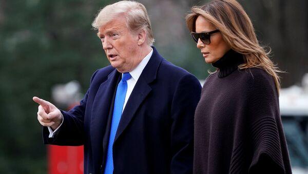 U.S. President Donald Trump and U.S. first lady Melania Trump walk to Marine One as they depart for Palm Beach from the White House in Washington, U.S., February 15, 2019 - Sputnik International