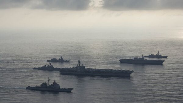 The aircraft carrier USS Ronald Reagan (CVN 76), second from bottom, lead ship of the Ronald Reagan Carrier Strike Group, the guided-missile cruiser USS Antietam (CG 54), bottom, and the guided-missile destroyer USS Milius (DDG 69), left, conduct a photo exercise with the Japan Maritime Self-Defense Force (JMSDF) helicopter destroyer JS Kaga (DDH 184), second from top, and the JMSDF destroyers JS Inazuma (DD 105) and JS Suzutsuki (DD 117). The Ronald Reagan Carrier Strike Group is forward-deployed to the U.S. 7th Fleet area of operations in support of security and stability in the Indo-Pacific region. - Sputnik International