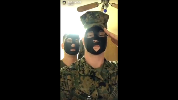 US Marines investigated after video surfaces, showing the pair posing in blackface - Sputnik International