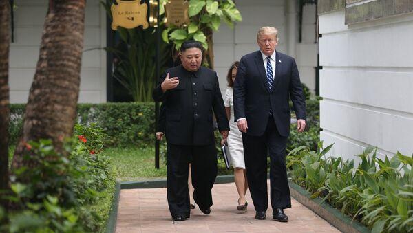 North Korea's leader Kim Jong Un and U.S. President Donald Trump talk in the garden of the Metropole hotel during the second North Korea-U.S. summit in Hanoi, Vietnam February 28, 2019 - Sputnik International