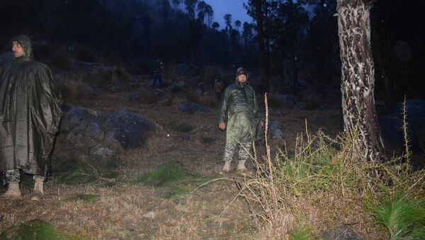 Pakistani soldiers and media personnel gather at the site where the Indian Air Force (IAF) strike launched on a Jaish-e-Mohammad (JeM) camp at Balakot on February 26, 2019 - Sputnik International