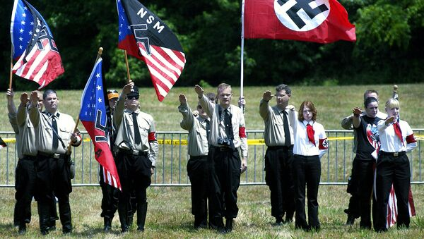 Members of the US National Socialist Movement (NSM) party and their supporters offer the Nazi salute during a rally in Virginia - Sputnik International
