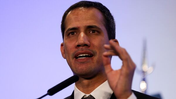 Venezuelan opposition leader Juan Guaido, who many nations have recognized as the country's rightful interim ruler, gestures during a news conference at the San Martin Palace in Buenos Aires, Argentina March 1, 2019 - Sputnik International