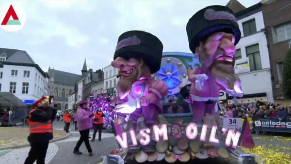Ugly face of #Antisemitism shows it's face in #Aalst #Belgium, as depiction of orthodox Jews standing on sacks of money, paraded through the town - Sputnik International