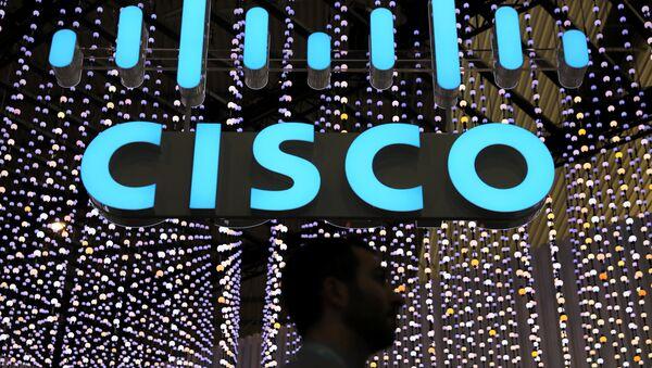 A man passes under a Cisco logo at the Mobile World Congress in Barcelona, Spain February 25, 2019 - Sputnik International