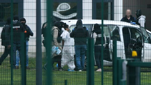 Michaël Chiolo, wearing a white forensic jumpsuit, is escorted into custody after the incident at Condon-sur-Sarthe prison - Sputnik International