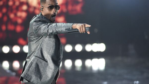 Will Smith gestures to the crowd as he performs Esta Rico at the Latin Grammy Awards on Thursday, Nov. 15, 2018, at the MGM Grand Garden Arena in Las Vegas. - Sputnik International