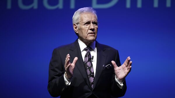 In this Oct. 1, 2018, photo, moderator Alex Trebek speaks during a gubernatorial debate between Democratic Gov. Tom Wolf and Republican Scott Wagner in Hershey, Pa. Jeopardy! host Trebek says he has been diagnosed with advanced -four pancreatic cancer. In a video posted online Wednesday, March 6, 2019, Trebek said he was announcing his illness directly to Jeopardy! fans in keeping with his long-time policy of being open and transparent. - Sputnik International