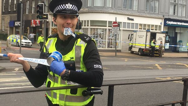 A police officer cordoning off a section of Prince's Street in Edinburgh. - Sputnik International