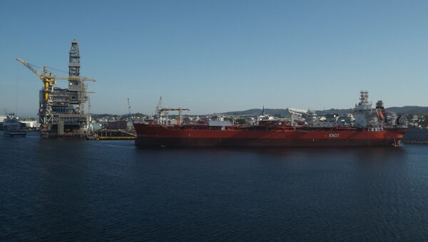 A KNOT oil tanker sails past a refinery in the Norwegian fjords. - Sputnik International
