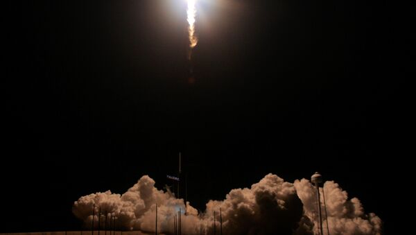 A SpaceX Falcon 9 rocket, carrying the Crew Dragon spacecraft, lifts off on an uncrewed test flight to the International Space Station from the Kennedy Space Center in Cape Canaveral, Florida, U.S., March 2, 2019 - Sputnik International