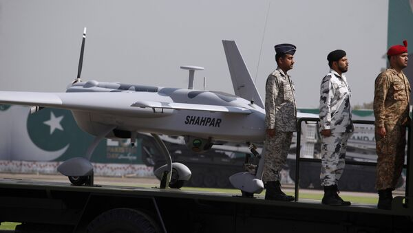 Pakistani soldiers stand beside a manufactured armed drone aircraft loaded on a vehicle is on display during a military parade in Islamabad, Pakistan, Friday, March 23, 2018.  - Sputnik International