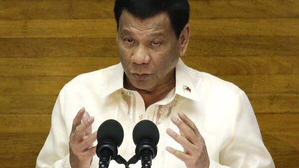 Philippine President Rodrigo Duterte gestures during his third State of the Nation Address at the House of Representatives in Quezon city, metropolitan Manila, Philippines Monday July 23, 2018 - Sputnik International