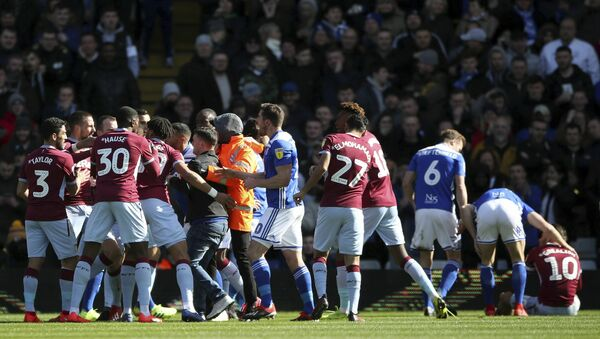 Aston Villa's Jack Grealish sits, nursing a sore head, after being punched by a Birmingham City fan at a game on 10 March 2019 - Sputnik International