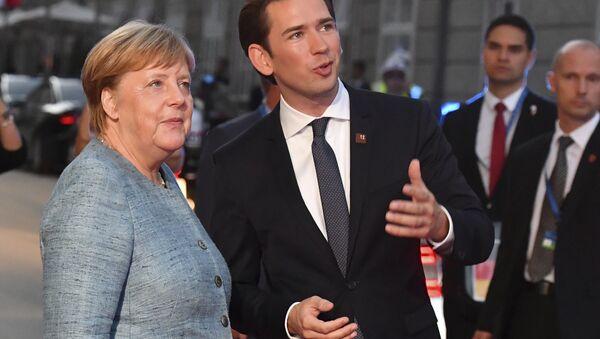 German Chancellor Angela Merkel talks to Austrian Chancellor Sebastian Kurz, right, when arriving at the informal EU summit in Salzburg, Austria, Wednesday, Sept. 19, 2018. - Sputnik International