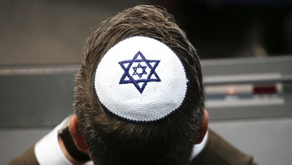 A member of the Christian Union party's faction wears a Jewish skullcaps, or kippa, during a debate at the German parliament Bundestag, about the 70th anniversary of the founding of the state Israel, in Berlin, Thursday, April 26, 2018 - Sputnik International