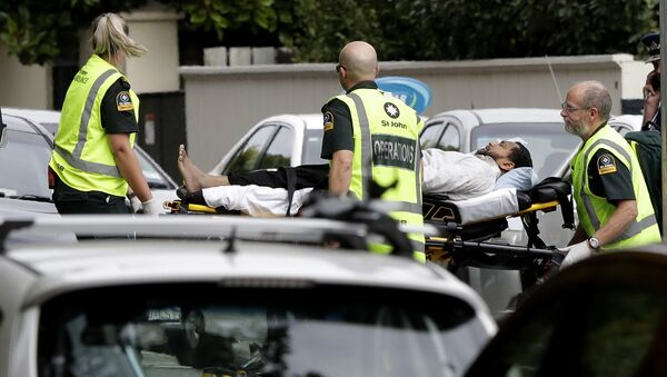 Ambulance staff take a man from outside a mosque in central Christchurch, New Zealand, Friday, - Sputnik International
