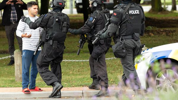 AOS (Armed Offenders Squad) push back members of the public following a shooting at the Masjid Al Noor mosque in Christchurch - Sputnik International