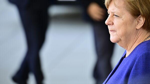 German Chancellor Angela Merkel waits for her guest, the Laotian Prime Minister, before a welcome ceremony and talks at the chancellery in Berlin on March 13, 2019 - Sputnik International