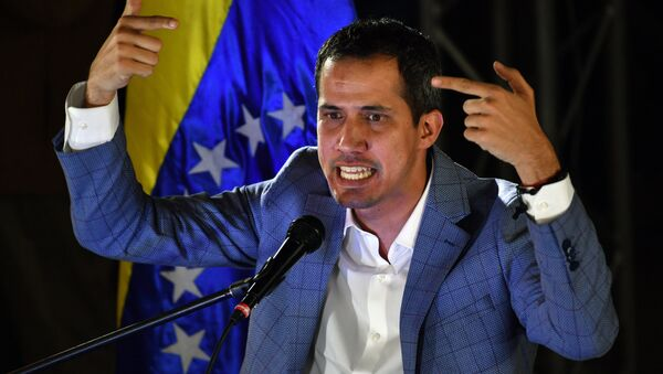 Venezuelan opposition leader and self-proclaimed interim president Juan Guaido delivers a speech during a meeting with local leaders in Caracas, on March 14, 2019. Venezuelans resumed work Thursday after a weeklong hiatus forced by an unprecedented nationwide blackout - Sputnik International