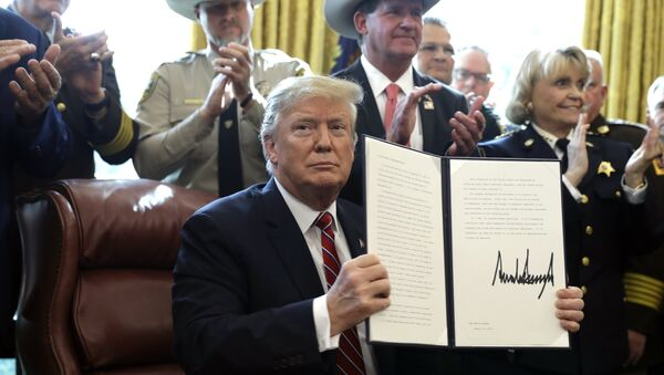 President Donald Trump speaks about border security in the Oval Office of the White House, Friday, March 15, 2019, in Washington. Trump issued the first veto of his presidency, overruling Congress to protect his emergency declaration for border wall funding. - Sputnik International