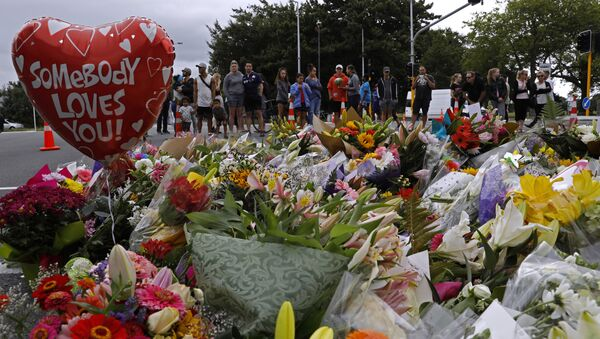 Mourners pay their respects at a makeshift memorial near the Masjid Al Noor mosque in Christchurch, New Zealand, Saturday, March 16, 2019 - Sputnik International