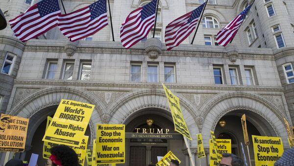 Activists walk past the front of the Trump International Hotel during the, Hands Off Venezuela!, 16 March, 2019, Washington - Sputnik International