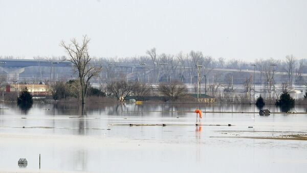 An orange windsock is seen at Offutt Air Force Base in Bellevue, Neb., site of the bases' flooded runway, Sunday, March 17, 2019. - Sputnik International