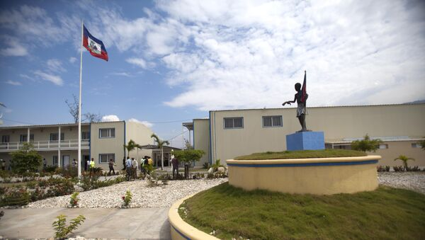 In this March 15, 2013 photo, Haiti's national flag flies outside parliament which was renovated by Chemonics International Inc., a for-profit international development company based in Washington D.C., in downtown of Port-au-Prince, Haiti. - Sputnik International