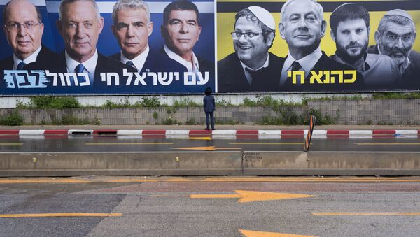 An Ultra-Orthodox Jewish man looks at an elections billboards of the Blue and White party leaders, from left to right, Moshe Yaalon, Benny Gantz, Yair Lapid and Gabi Ashkenazi, alongside a panel on the right showing Prime Minister Benjamin Netanyahu flanked by extreme right politicians, from the left, Itamar Ben Gvir, Bezalel Smotrich and Michael Ben Ari in Bnei Brak, Israel, Saturday, March 16, 2019. Hebrew reads on the left billboard The nation of Israel lives and on the right billboard Kahana Lives in a reference to a banned ultranationalist party in the 1994. - Sputnik International
