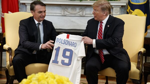 President Donald Trump presents Brazilian President Jair Bolsonaro with a U.S. national team soccer jersey during a meeting in the Oval Office of the White House, Tuesday, March 19, 2019, in Washington. (AP Photo/Evan Vucci) - Sputnik International