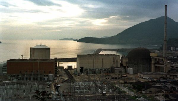 The Angra 2 nuclear reactor dome at right is seen in Angra dos Reis, Brazil, in this photo taken November 24, 1998. Delayed for more than a decade by cost overruns and safety concerns, the Angra 2 reactor at last will be finished. Critics say that the location of the plant, in a scenic bay west of Rio de Janeiro is an environmental hazard. They claim that the functioning Angra 1 reactor, the cilinder shaped building at left, was built on unstable crumbling stone, not on bedrock. - Sputnik International