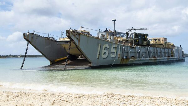 Landing Craft, Utility (LCU) 1651, assigned to Naval Beach Unit (NBU) 7, stands by to retrieve Marines assigned to the 31st Marine Expeditionary Unit (MEU) during a simulated beach raid. The amphibious transport dock ship USS Green Bay (LPD 20), part of the Commander Amphibious Squadron 11, is operating in the region to enhance interoperability with partners and serve as a ready-response force for any type of contingency. - Sputnik International